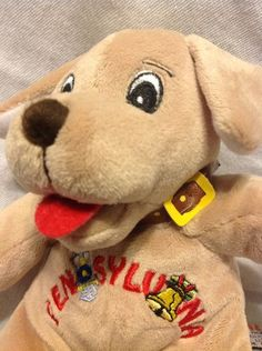 This 7 inch Souvies Puppy was a part of a collection over the years and was never used or played with.  The puppy is a soft, squeezable beanbag plush. The puppy is in excellent condition for its age and his tags are still attached.  The puppy has resided in a smoke free environment.