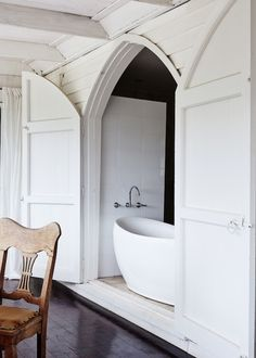 A surprise bathroom! 'The church had 3 double doors overlooking the garden and the river before the veranda was added in 1960. This is one o...