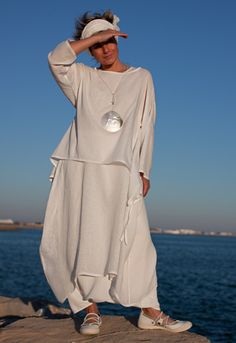 white cotton gauze top worn over a white gauze tunic dress and mixed with linen harem pants