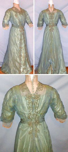 Afternoon dress, 1902. Changeable blue/gold organdy with blue silk floral appliqués. Beige net with lace collar, trimmed in back with decorative blue buttons. Skirt opens in front to reveal blue silk underskirt. Swag design on rear hemline. Fiddybee/ebay