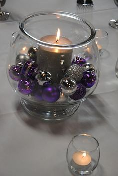 small ornaments in our colors could be pretty for a winter wedding...maybe with a mirror underneath to reflect the candle & colors :)