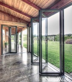 folding-glass-doors: WALLS This is what we want for outdoor patio option for winter vs summer . to bring the outdoors IN. Floor To Ceiling Windows, Windows And Doors, Wall Of Windows, Sunroom Windows, Garage Door Windows, Metal Windows, Modern Windows, The Doors, Future House