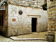 *5th STATION 5: 5th station of the cross on the via dolorosa. Simon of Cyrene helps Jesus to carry his cross.