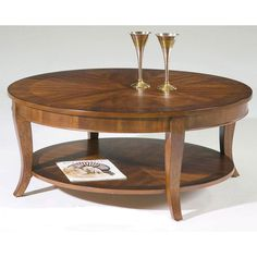 38 x 19 $296  Bradshaw Round Coffee Table - The Bradshaw Round Coffee Table is a lovely occasional table with traditional elegance. Constructed of select hardwoods with cherry and walnut veneers...