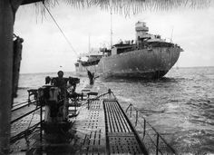 U-183 approaches the German supply ship 'Brake' in order to refuel.