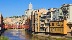 About an hour's train ride from Barcelona, Girona's picturesque houses overlooking the Onyar River, ancient cathedral --and its Catalan Gothic architecture -- and the old city walls and lookout towers draws sightseeing day-trippers.
