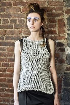 Jersey cotton chunky knit deconstructed vest. Hand knitted. One side shorter.  Intentional irregularities.  Fully reversible, front and back, inside and out.  Comes in 6 different colors:  Grey, Safari Green, Forest Green, True Blood Red, Chocolate and Lipstick Red.