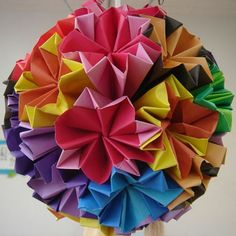 """~ info on which pages to visit, depending on you origami skills...from beginners to those with more experience!   (""""Modular Origami - This kind of ball takes more patience because it is constructed from MANY folded squares. Each square is folded into a similar shape that fits in with the other squares to form a geodesic sphere or ball"""")"""