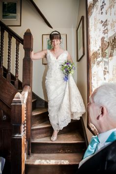 The bride coming down the stairs inside Beacon House on her way to the wedding ceremony.