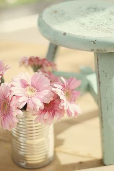 Sweet little stool and plan tin can with pink flowers