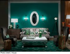 Green may be a cool color, but emerald adds warmth and coziness to a space because of it's depth.