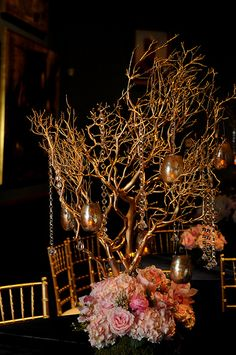 Centerpiece Option--gold manzanita trees with hanging mercury glass votives--arrangement in white and ivory at the base of branches