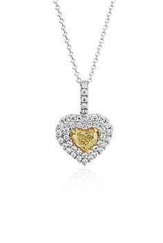 Give a special something to your sweetheart! A heart-cut yellow diamond glows at the center of two pavé diamond halos.