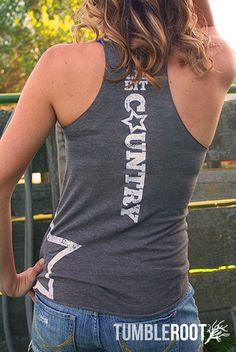 "Adorable ""Lil' Bit Country"" star tank top! The perfect country concert tank. Pairs well with a cold beer. Quincy is 5'4 and wearing a size Extra Small in this photo."