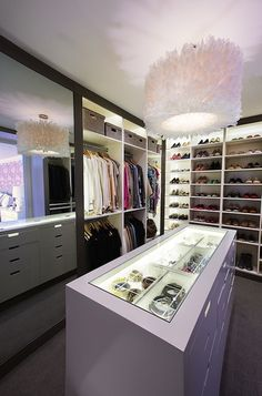Custom closet with glass top accessory storage cabinet. Great organization! #closets #customclosets