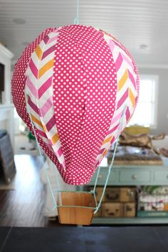 if you know me and DIY's, you know you're in for a long post! i'm not just going to show you how to make one hot air balloon, i'm going to show you how to make 17 different balloons! 3 or 4 times ...