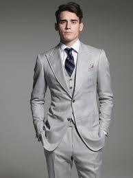 Thank you Tom Ford for making even ugly guys remotely good looking. Every man should have at least one Tom Ford Suit. Kind of like a girls LBD.