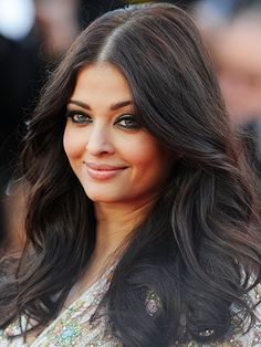 ROUND FACES The center-part For women with round faces, it's best to pair a center-part with long layers and soft curls, says Mitchell. To get Aishwarya Rai's gorgeous locks, use a large-barrel curling iron to create loose curls, then run fingers through hair.