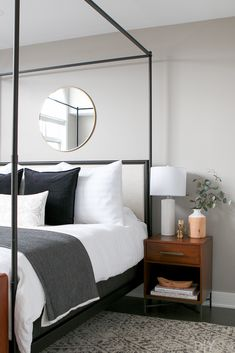 The wood accessories from HomeGoods help tie this master bedroom together. Love the wood bowl on top of pretty books, and you can display dried eucalyptus in a wood and white vase right on your nightstand. (Sponsored Pin).