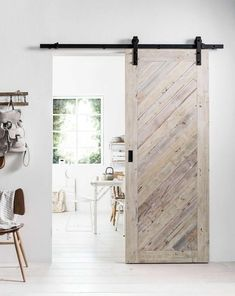 Doors that make tiny spaces feel bigger Doors that make small spaces feel bigger. Changing up something as simple as the doors in your home can really help you maximise the space you have. Barn doors and pocket doors are game changers in small homes. Barn Door Closet, Diy Barn Door, Diy Door, Barn Door To Bathroom, Barn Door In Bedroom, Making Barn Doors, Barn Door Hardware, Wooden Sliding Doors, Wooden Barn Doors