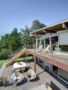 Architecture, Outdoor Dining Area Under Staircase Rustic Modern House Design With Wooden Floor Tiles And Deck With Rattan Lounge Chairs Ideas ~ Far Pond Designed by Bates Masi Architects Kit Homes, Covered Back Patio, Design Exterior, New York Homes, Deck Railings, Railing Ideas, Waterfront Property, Wooden Decks, Home Upgrades