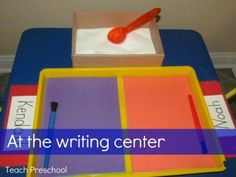 Student can spoon sand onto trays and trace names with the paint brush. Could also paint names with glue and drop sand on to make a friend's name: An invitation to play at the writing center from Teach Preschool