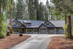 GARAGE LAYOUT---A charming Craftsman-style home with an abundance of glass windows and dark gray roof that goes quite well with the surrounding tall trees. Craftsman Style Homes, Ranch Style Homes, Craftsman House Plans, Ranch Homes, Craftsman Ranch, Craftsman Kitchen, House Plans One Story, Story House, House Floor Plans