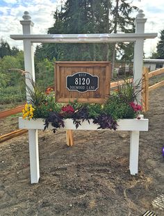 Finally finished building our new driveway sign/planter. Totally in love 💜 - Finally finished building our new driveway sign/planter. Totally in love 💜 Driveway Entrance Landscaping, Driveway Sign, Diy Driveway, Backyard Landscaping, Driveway Markers, Landscaping Ideas, Garden Yard Ideas, Lawn And Garden, Farm Entrance