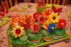 Flower garden cupcakes.  Made from marshmallows and different cookies with candies.  Cute idea.