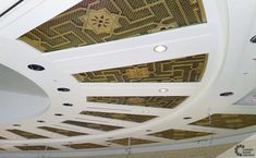Group of 40 beautiful carved wood latticework panels displayed around a circle in the main room of the Oran Convention Center. The design and distribution was planned to allow different natural illumination possibilities.  The panels were carved in both sides of a Bosse wood piece creating clean and modern geometric Arabian star motifs. Finally, all panels were varnished with gold leaf.