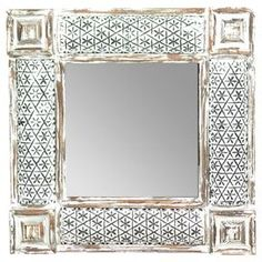 """Distressed wood-framed wall mirror.   Product: Mirror    Construction Material: Wood and mirrored glass    Color: Antique white and silver     Dimensions: 23"""" H x 23"""" W x 2"""" D"""
