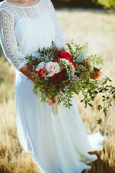Rustic Red Bouquet | SouthBound Bride | http://www.southboundbride.com/rustic-jewel-tone-wedding-at-roodezand-by-wrensch-lombard | Credit: Wrensch Lombard