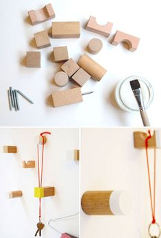 Wooden building blocks, dipped in paint and used as hooks. I LOVE this! So natural and simple.