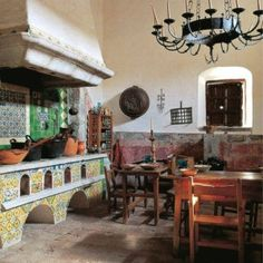 Traditional Mexican Kitchens With Chandelier And Large Hood And Rustic