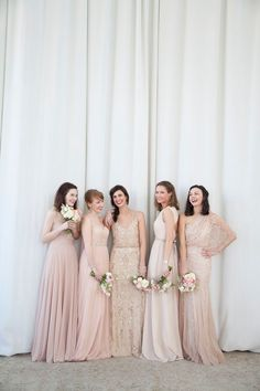 Mismatched Bridesmaid Dresses – Neutral (Keeping things neutral is the easiest way to exercise some control over mismatched mayhem, and also bring some formality to the overall look. Try mixing light pinks with off-white or cream, and mix and match fabrics instead. Floaty tulle skirts, lace sleeves, beading and sequins will all elevate the overall look and provide real depth and texture.)