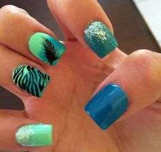 I wouldn't have my nails all different colors but I do like the ombré nail with a feather and the striped nail.