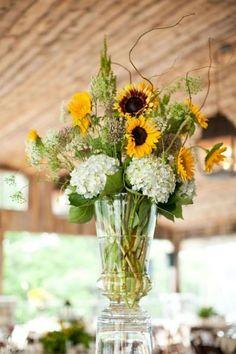sunflower wedding centerpieces / http://www.himisspuff.com/country-sunflower-wedding-ideas/6/