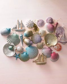 Trim your tree with treasures from the sea. These shell ornaments are dusted with two shades of glitter and blended for a dazzling ombre effect.