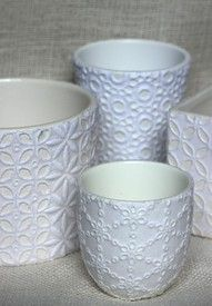 fun and pretty little idea. Take a ceramic cup or bowl or whatever you like. Get a piece of lace and modge podge it to the ceramic. Then paint. Makes a beautiful original piece.