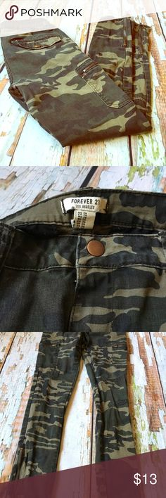 Forever 21 Camo Cargo Skinny Jeans Amazing skinny jeans with zippered ankles and Cargo pockets. Military style camo jeans by Forever 21. Have one small spot on knee and normal wash wear. Inseam and waist measurements pictured. Forever 21 Jeans Skinny
