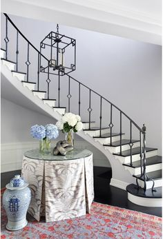 Foyer.  Lantern was meant to echo the original 1930s banister on staircase.