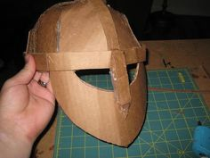 Happily Ever Crafter: DIY: Building a Medieval Helmet Out of Cardboard Medieval Crafts, Medieval Party, Medieval Banner, Medieval Fair, Knights Helmet, Viking Helmet, Soldier Helmet, Cardboard Mask, Cardboard Crafts