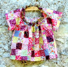 I wished to  create a  piece of clothing for Angélique using the simplest patchwork.  Most of the Liberty and batik fabrics I snipped and stitched were remnants of tiny clothes made for hares and mice created over the past two years.