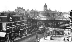 Aerial view of Brixton Road, looking towards the railway bridge and Bon Marche, the first purpose built department store in England.