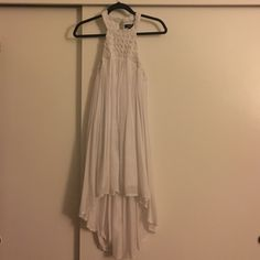 LF White Dress Beautiful LF white high-low dress. Size 8 so would fit a US S/M. Super cute in perfect condition, as it has never been worn. Beautiful flowly look, perfect for a date night of causal day dress depending on what shoes you wear. LF Dresses Midi