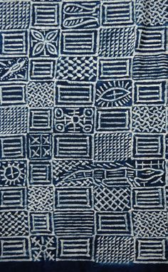 Africa | Detail from a Ukara cloth from the Leopard Society.  Igbo people of Nigeria | 3 plain weave panels/stitch/resist on cotton dyed with indigo | 20th century || Partial view