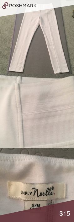 """White pants/leggings with spandex sides S/M (8-10) New never worn!  Dress them up or down! White leggings fit tight to your body.  Nice tucked into boots or wearing with sandals.  The sides have the spandex as seen in the picture.  Top of pants measures 14 1/4"""" Hips 17 1/2"""" Length 40 1/2"""" Inseam 30"""" Top of leg 11"""" Knee 7 1/2"""" Ankle 5 3/4"""" 73% polyester 22% rayon 5% spandex SIMPLY Noelle Pants Leggings"""