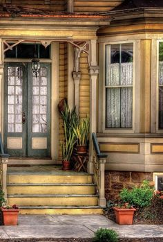 A charming front porch, and a big bay window? Yes, please, I could fix this right up. ~~  Houston Foodlovers Book Club