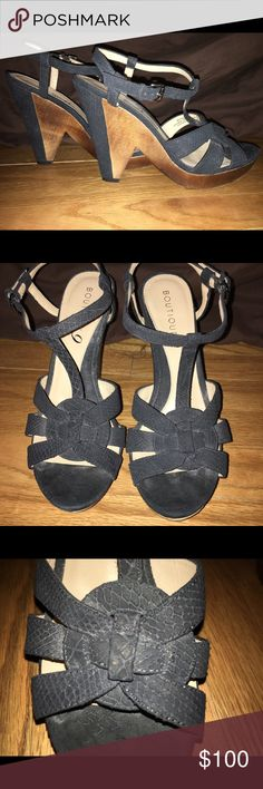Subtle Snake Unique take on a wedge heel. Strappy black suede with subtle snake skin print. Wood accents on the platform. Statement worthy!!!! Boutique 9 Shoes Wedges