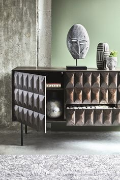 Bring a touch of texture to your interior with the Amos sideboard. This unique piece features a tactile, raised front and is finished in rich, dark wood.